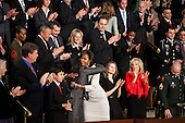 First Lady Michelle Obama hugs Roxanna Green as she enters the House Chamber prior the State of the Union address at the United States Capitol in Washington, D.C., Tuesday, January 25, 2011. John and Roxanna Green are the parents of eleven-year-old Dallas and the late Christina Taylor, the nine-year-old girl killed when a gunman opened fire on Rep. Gabrielle Giffords in Tucson earlier this month. .Mandatory Credit: Chuck Kennedy - White House via CNP
