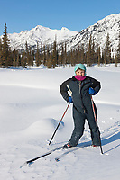 Leo hicker, cross country skiing in the Brooks Range mountains, Arctic, Alaska.