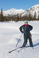 Leo hicker, cross country skiing in the Brooks Range mountains, Arctic, Alaska.