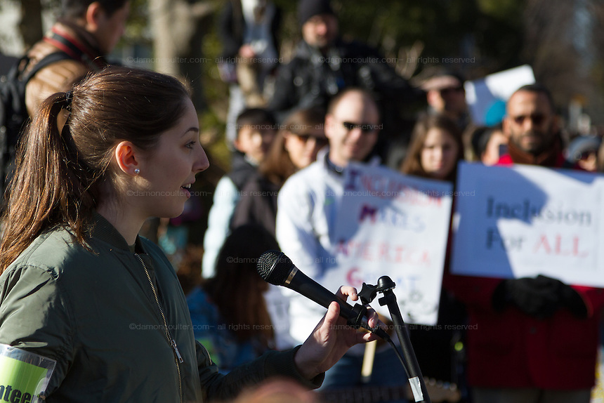 A High School student named Greta Morganstern speaks at a protest march and rally organised by the Alliance for an Inclusive America group against the perceived anti-Muslim and anti-foreigner immigration policies of President Donald Trump, Shibuya, Tokyo, Japan. Sunday February 12th 2017. The Alliance of an Inclusive America is a multi-faith non-partisan group. About 250 Americans, other ex-pats and japanese people took part in the march to show people around the world they reject the Executive Order President Trump enacted at the end of January, indefinitely suspending the resettlement of Syrian refugees and temporarily banning people from seven majority Muslim countries from entering the United States.