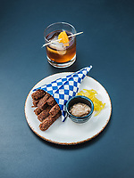 A Sorghum Old Fashioned cocktail and scrapple fries at Julep Restaurant in Denver, Colorado, Friday, July 20, 2018.<br /> <br /> Photo by Matt Nager