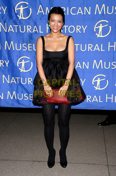SANA-A IM-PROPP.Roberto Cavalli sponsors the American Museum of Natural History's annual Winter Dance held at the museum, New York, New York, USA..March 11th, 2008.full length black dress red clutch bag purse sana a im propp.CAP/ADM/BL.©Bill Lyons/AdMedia/Capital Pictures.