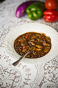 Black bean chili with legumes, end of season tomatoes, peppers & chiles, and eggplant.