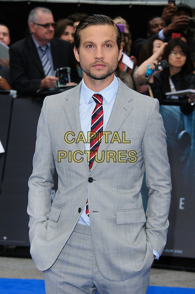 Logan Marshall-Green.'Prometheus' film premiere held at the Empire Leicester Square, .London, England , UK, 31st May 2012..half length grey gray suit stubble facial hair hands in pockets red blue navy striped tie .CAP/CJ.©Chris Joseph/Capital Pictures.