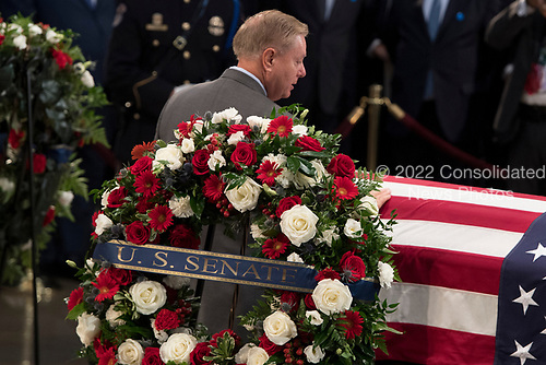 US Senatot Lindsey Graham pays his respects to the flag-draped casket bearing the remains of John McCain, who lived and worked in Congress over four decades, in the U.S. Capitol rotunda for a farewell ceremony and public visitation, in Washington, Friday, Aug. 31, 2018. McCain was a six-term senator from Arizona, a former Republican nominee for president, and a Navy pilot who served in Vietnam where he endured five-and-a-half years as a prisoner of war. He died Aug. 25 from brain cancer at age 81.