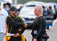 Mar 15, 2019; Gainesville, FL, USA; NHRA funny car driver J.R. Todd (left) greets Tim Wilkerson during qualifying for the Gatornationals at Gainesville Raceway. Mandatory Credit: Mark J. Rebilas-USA TODAY Sports