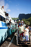FRENCH POLYNESIA, Moorea. Passengers disembarking off a ferry from Papeete, Tahiti.