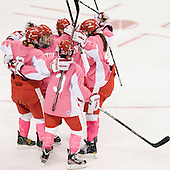 Kasey Boucher (BU - 3), Jenn Wakefield (BU - 9), Jill Cardella (BU - 22), Kayla Tutino (BU - 8) and Kathryn Miller (BU - 4) celebrate Cardella's goal. - The Boston University Terriers defeated the visiting Northeastern University Huskies 3-2 on Saturday, January 28, 2012, at Agganis Arena in Boston, Massachusetts.