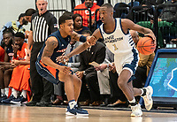 WASHINGTON, DC - NOVEMBER 16: Shawn Walker Jr. #1 of George Washington dribbles past Isaiah Burke #2 of Morgan State during a game between Morgan State University and George Washington University at The Smith Center on November 16, 2019 in Washington, DC.