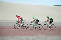 Stig Broeckx (BEL/Lotto-Belisol) leading the peloton in front of the Belkin train between the dunes next to the sea<br /> <br /> 3rd World Ports Classic 2014<br /> stage 1: Rotterdam - Antwerpen 195km