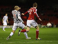 Sam Parkin flicks the ball past Mark Reynolds in the Aberdeen v St Mirren Scottish Communities League Cup match played at Pittodrie Stadium, Aberdeen on 30.10.12.