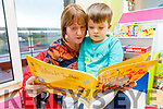 Valerie Foley reading a book to her son Darragh which was gifted to the Cashel Ward by the Raheen Play Group from Killarney on Saturday.