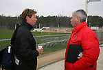 15 December 2007: Wake Forest head coach Jay Vidovich (l) and Ohio State head coach John Bluem (r) talk before the press conference. The Ohio State Buckeyes held a press conference at SAS Stadium in Cary, North Carolina one day before playing in the NCAA Division I Mens College Cup championship game.
