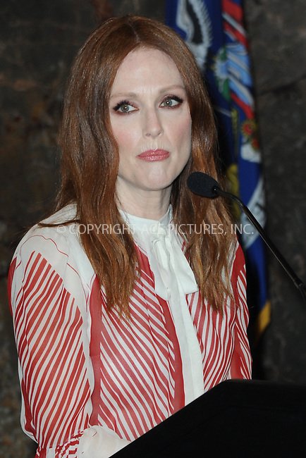 www.acepixs.com<br /> June 1, 2017 New York City<br /> <br /> Julianne Moore lights The Empire State Building orange in honor of National Gun Awareness Day on June 1, 2017 in New York City. <br /> <br /> <br /> Credit: Kristin Callahan/ACE Pictures<br /> <br /> Tel: 646 769 0430<br /> Email: info@acepixs.com