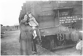 Portrait of Mary Smith, with her son Oren, standing by D&amp;RGW gondola car in Santa Fe.<br /> D&amp;RGW  Santa Fe, NM  Taken by Montoya, Dolores Ortiz - 1930-1939