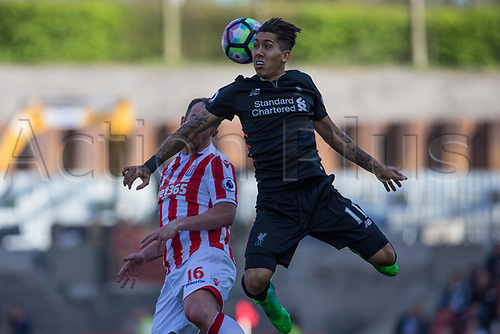 April 8th 2017, bet365 Stadium, Stoke on Trent, Staffordshire, England; EPL Premier League football, Stoke City versus Liverpool; Liverpool's Roberto Firmino heads the ball under pressure from Charlie Adam