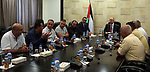 Palestinian Prime Minister, Rami Hamdallah, meets with member of the representatives of the Popular Committees for Camps, in the West Bank city of Ramallah, on July 23, 2017. Photo by Prime Minister Office