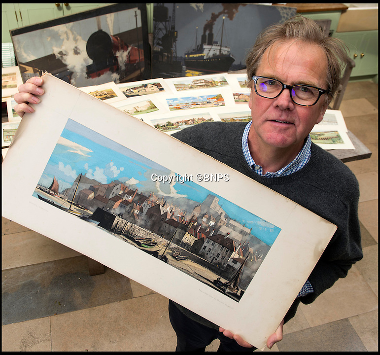 BNPS.co.uk (01202 558833)<br /> Pic: TomWren/BNPS<br /> <br /> Patrick Bogue from Onslows Auctioneers with the posters.<br /> <br /> A collection of vintage posters used to promote Britain's railways during the golden age of steam have gone on sale for a whopping &pound;20,000 after being saved from the skip.<br /> <br /> Quick-thinking railway worker Albert Cook heard the 130 carriage panel prints from the 1930s including 12 original artworks were to be thrown away at London's Liverpool Street Station, so he asked permission to take them home.<br /> <br /> The art deco-style posters advertised popular destinations such as Northumberland's Whitley Bay, Woodhall Spa in Lincs and Dovercourt Bay in Essex as railway tourism opened up Britain to the masses.<br /> <br /> The archive will be sold by Onslows auctioneers in Blandford, Dorset, on July 14.