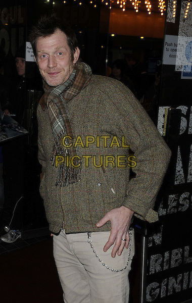 "Jason Flemyng.The ""Macbeth"" press night performance, Trafalgar Studios, Whitehall, London, England..February 22nd, 2013.half length brown check scarf sweater jumper stubble facial hair.CAP/CAN.©Can Nguyen/Capital Pictures."