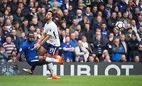 Victor Moses of Chelsea clears from Mousa Dembele of Spurs during the Premier League match between Chelsea and Tottenham Hotspur at Stamford Bridge, London, England on 1 April 2018. Photo by Andy Rowland.