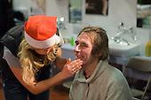 A homeless 'guest' receives a face massage from a volunteer at the Crisis Open Christmas shelter in the London Arena, Docklands.