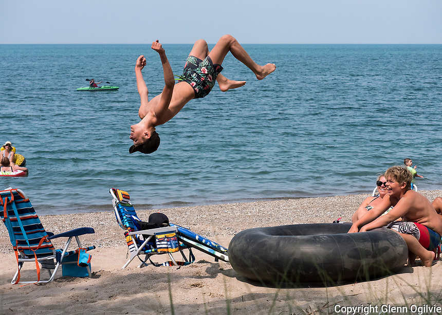 Large inner tubes are made for more than floating on. Simon Prins, 13, uses his inner tube as a launch pad to do backflips to the delight of his friend Evan White, 12, both of Sarnia. Simon returns to Grade 8 at Cathcart Blvd School while Evan will attend Grade 8 at Lake Road Public School.