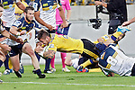 Hurricanes' halfback TJ Perenara, centre, dives over the line to score a try against the ACT Brumbies in the Super Rugby match at Westpac Stadium, Wellington, New Zealand, Friday, March 07, 2014. Credit: Dean Pemberton
