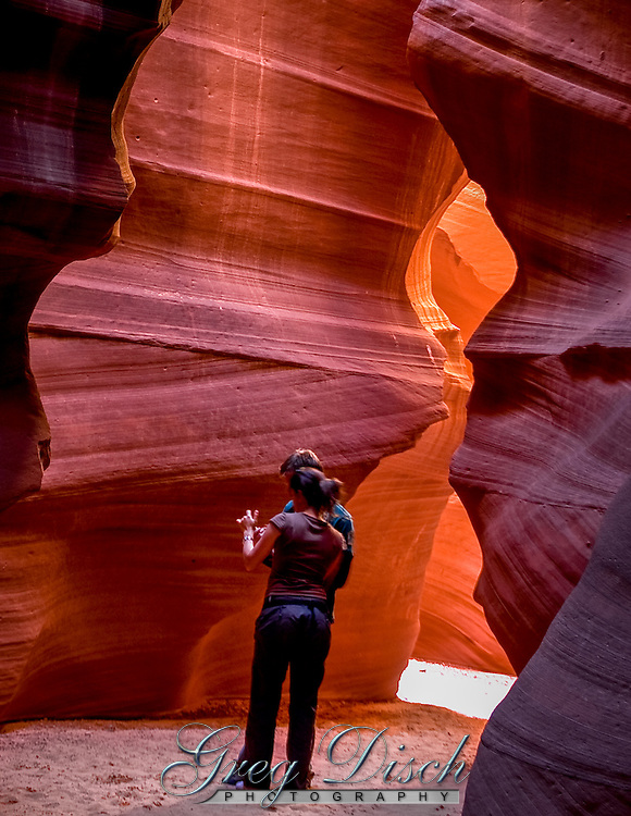 Antelope Canyon was formed by erosion of Navajo Sandstone, primarily due to flash flooding and secondarily due to other sub-aerial processes. Rainwater, especially during monsoon season, runs into the extensive basin above the slot canyon sections, picking up speed and sand as it rushes into the narrow passageways. Over time the passageways are eroded away, making the corridors deeper and smoothing hard edges in such a way as to form characteristic 'flowing' shapes in the rock.