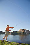 Fly fisherman casts his fly fishing line into Canyon Lake