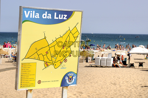 Beach at the resort of Praia da Luz, Algarve, Portugal..August 2012.gv general view summer water sand sign yellow map tourists .CAP/PP/BK.©Bob Kent/PP/Capital Pictures