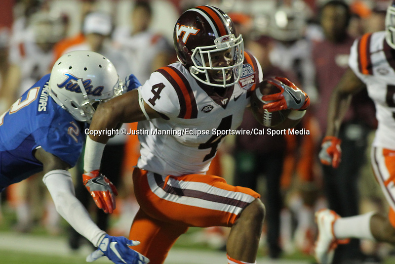 December 26, 2015: Virginia Tech TB J.C. Coleman running the ball during the 2nd half of the Camping World Independence Bowl at Independence Stadium in Shreveport, LA. Justin Manning/ESW/CSM