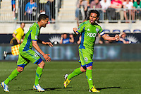 Mauro Rosales (10) of the Seattle Sounders celebrates scoring with Lamar Neagle (27) during the second half against the Philadelphia Union The Philadelphia Union and the Seattle Sounders played to a 2-2 tie during a Major League Soccer (MLS) match at PPL Park in Chester, PA, on May 4, 2013.