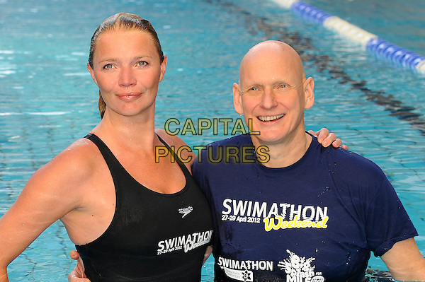 Jodie Kidd & Duncan Goodhew.The annual Swimathon 2012 charity swim, Oasis Sports Centre, London, England..January 5th, 2012.half length black blue t-shirt bathing suit swimsuit water pool.CAP/CJ.©Chris Joseph/Capital Pictures.