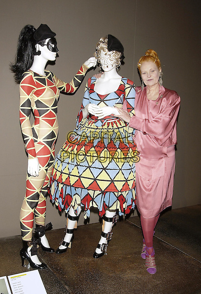 VIVIENNE WESTWOOD.The Victoria & Albert ( V&A ) Museum launches a major exhibition of the work of Vivienne Westwood, one of the most influential fashion designers of the last 30 years..30 March 2004.full length, full-length, pink satin dress, mannequin dress, models.www.capitalpictures.com.sales@capitalpictures.com.©Capital Pictures