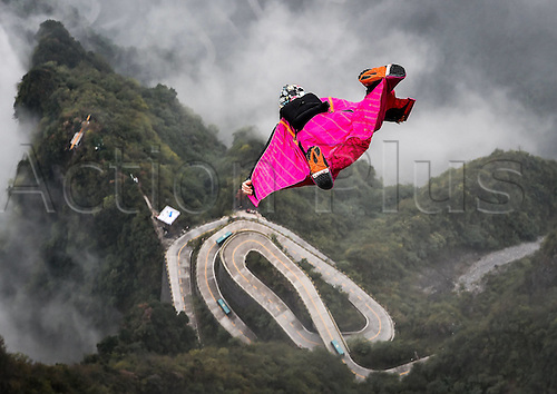 13.10.2016. Zhangjiajie, Hunan Province, China.  Vincent Descols of France glides during the qualification of World Wingsuit League (WWL) China Grand Prix 2016 in Zhangjiajie,   Hunan Province, Oct. 13, 2016. Only ten of the total sixteen fliers took part in the competition due to the weather on Thursday.