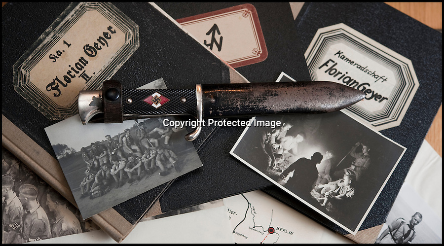 BNPS.co.uk (01202 558833)<br /> Pic: Mullocks/BNPS<br /> <br /> ***Please Use Full Byline***<br /> <br /> Hitler Youth dagger with swastika on the handle with pictures and diaries.<br /> <br /> Sinister archive illustrating the Nazi brainwashing of German youth comes to light...<br /> <br /> A chilling archive of an enthusiastic member of the Hitler Youth has emerged to highlight how the Nazi's brainwashed German children in the build up to WW2<br /> <br /> Helmut Nieboy kept detailed diaries during his time with the German equivalent of the Boy Scouts from 1933.<br /> <br /> Helmut also amassed a number of photographs of his time with the paramilitary group, showing the youngsters sitting around a campfire, marching and at rallies. <br /> <br /> The diaries also include incredibly detailed route marches as well as hand drawn portraits of the beloved Fuhrer with patriotic slogans.<br /> <br /> The archive, that also includes his Hitler Youth tent, knife and trumpet, are being sold by Mullock's Auctioneers of Shropshire.