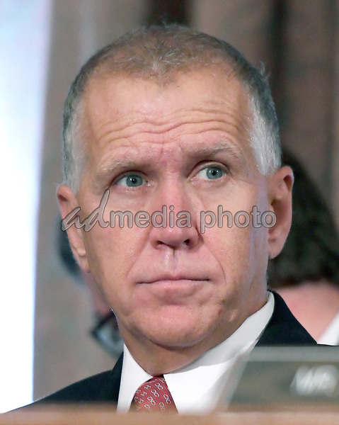 "United States Senator Thom Tillis (Republican of North Carolina) listens as Richard F. Smith, former Chairman and Chief Executive Officer, Equifax, Inc. gives testimony before the US Senate Committee on Banking, Housing, and Urban Affairs as they conduct a hearing entitled, ""An Examination of the Equifax Cybersecurity Breach"" on Capitol Hill in Washington, DC on Tuesday, October 3, 2017. Photo Credit: Ron Sachs/CNP/AdMedia"