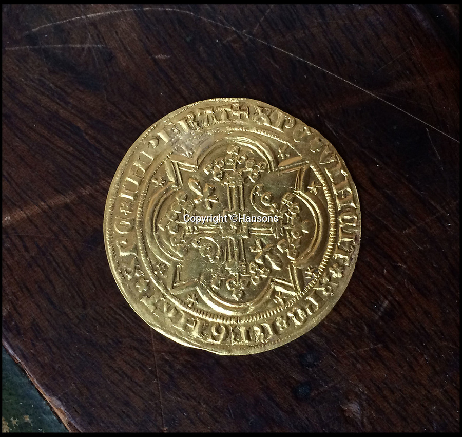 BNPS.co.uk (01202 558833)<br /> Pic: Hansons/BNPS<br /><br />£3000 gold coin found in £80 bureau.<br /> <br /> A woman has told of her delight after a 700-year-old gold coin worth £3,000 was found in a secret drawer in a writing desk a relative had left her.<br /> <br /> Amy Clapp, 37, had no idea the 22ct French coin was inside the 20th century bureau and it was only four after she sent the item of furniture off to auctioneers.<br /> <br /> Furniture expert Edward Rycroft discovered it when he examined the bureau at Hansons Auctioneers.<br /> <br /> The coin is a Raymond IV Prince of Orange Franc A Pied coin dating back to 1365.