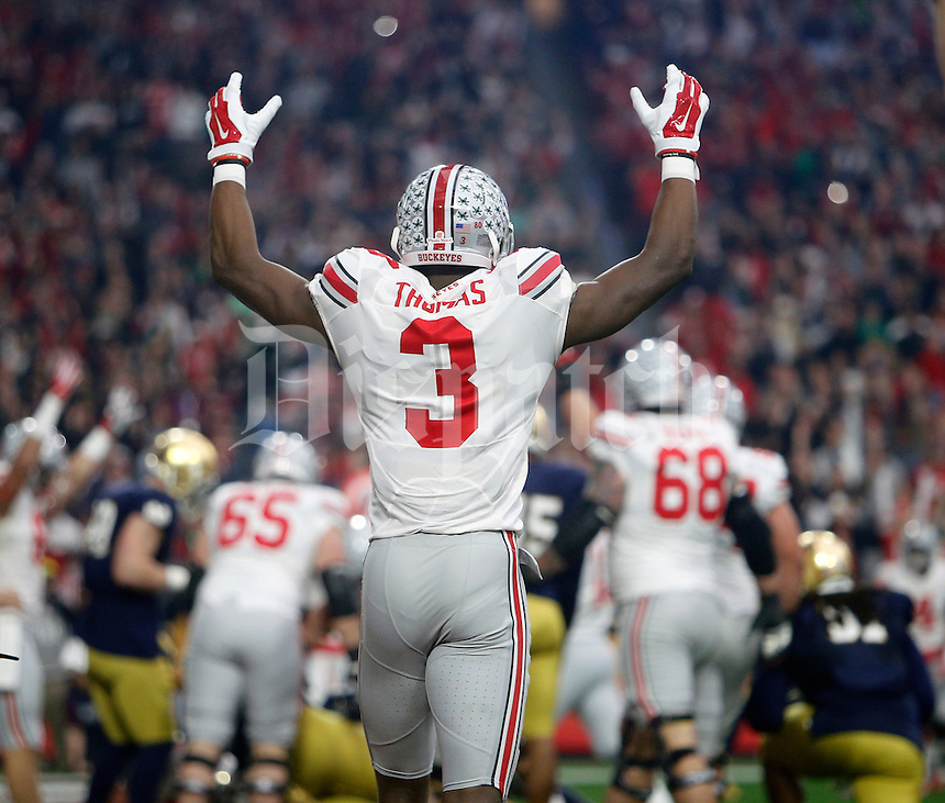 Ohio State Buckeyes wide receiver Michael Thomas (3) celebrates the first touchdown of the game against Notre Dame Fighting Irish in the first quarter during the Fiesta Bowl in the University of Phoenix Stadium on January 1, 2016.  (Dispatch photo by Kyle Robertson)