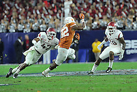 NWA Media/Michael Woods --12/29/2014-- w @NWAMICHAELW...University of Arkansas defenders Martrell Spaight (47) and Josh Liddell (28) tackle Texas running back Johathan Gray in the 1st quarter of the Razorbacks 31-7 win over Texas during the Texas Bowl Monday night at  NRG Stadium in Houston.