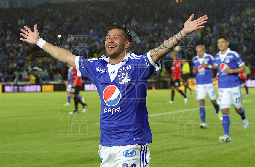 BOGOTA-COLOMBIA-17-03-2013.José Tancredi de Millonarios celebra su gol convertido de tiro penalty ante el Cúcuta Deportivo, partido correspondiente a la Liga Postobón I en el estadio El Campín .Millionaires Jose Tancredi celebrates his goal converted penalty shot against Cucuta Deportivo, league game for the Postobon I in the Campin Stadium.Photo / VizzorImage / Felipe Caicedo / Staff
