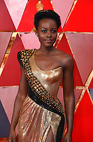 Lupita Nyong'o arrives at the Oscars on Sunday, March 4, 2018, at the Dolby Theatre in Los Angeles. (Photo by Richard Shotwell/Invision/AP)