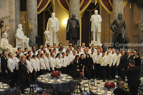 Washington, DC - January 20, 2009 -- The servers at the inaugural luncheon pose for a group photograph in Statuary Hall at the U.S. Capitol in Washington DC a few hours before Barack Obama is sworn in as the 44th U.S. President on January 20, 2009..Credit: Amanda Rivkin - Pool via CNP