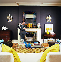 Philip Gorrivan stands in the sumptuously decorated living room of his Manhattan brownstone