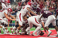 Hawgs Illustrated/Ben Goff<br /> Cole Kelley, Arkansas quarterback, recovers his own fumble for a touchdown in the 2nd quarter vs Texas A&M Saturday, Sept. 29, 2018, during the Southwest Classic at AT&T Stadium in Arlington, Texas.