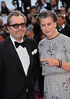 Gary Oldman &amp; Gisele Schmidt at the closing gala screening for &quot;The Man Who Killed Don Quixote&quot; at the 71st Festival de Cannes, Cannes, France 19 May 2018<br /> Picture: Paul Smith/Featureflash/SilverHub 0208 004 5359 sales@silverhubmedia.com