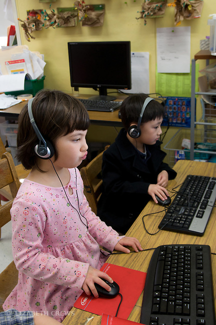Berkeley CA Kindergarten students learning via computers in class