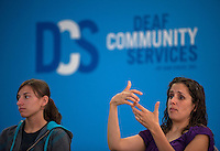 "From my assignment at the San Diego military photographers' workshop. Theme was ""Gesture."" Using my rudimentary sign language skills I managed to talk my way into a meeting of the San Diego deaf community council."