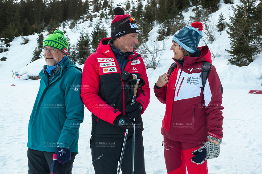 Switzerland. Canton Ticino. Swiss-Cups Campra. Cross Country Skiing. FIS Classic Sprint Race. Hippolyt Kempf () is the Cross Country Skiing Chef by Swiss-Ski. He smiles while talking to a friends couple. Hippolyt Kempf (born 10 December 1965) is a Swiss Nordic combined skier who competed during the late 1980s and early 1990s. He won a complete set of Olympic medals, earning two of them at the 1988 Winter Olympics in Calgary (gold: 15 km individual, silver: 3 x 10 km team) and the third at the 1994 Winter Olympics in Lillehammer (bronze: 3 x 10 km team). Kempf also earned a 3 x 10 km team silver medal at the 1989 FIS Nordic World Ski Championships in Lahti. Swiss-Ski is a branch of Swiss Olympic. The Fédération Internationale de Ski (FIS; English: International Ski Federation) is the world's highest governing body for international winter sports. Founded  on 2 February 1924, it is responsible for the Olympic disciplines of cross-country skiing. The FIS is also responsible for setting the international competition rules. 4.01.2020 © 2020 Didier Ruef