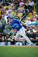 Toronto Blue Jays second baseman Darwin Barney (18) at bat during a Spring Training game against the Pittsburgh Pirates on March 3, 2016 at McKechnie Field in Bradenton, Florida.  Toronto defeated Pittsburgh 10-8.  (Mike Janes/Four Seam Images)